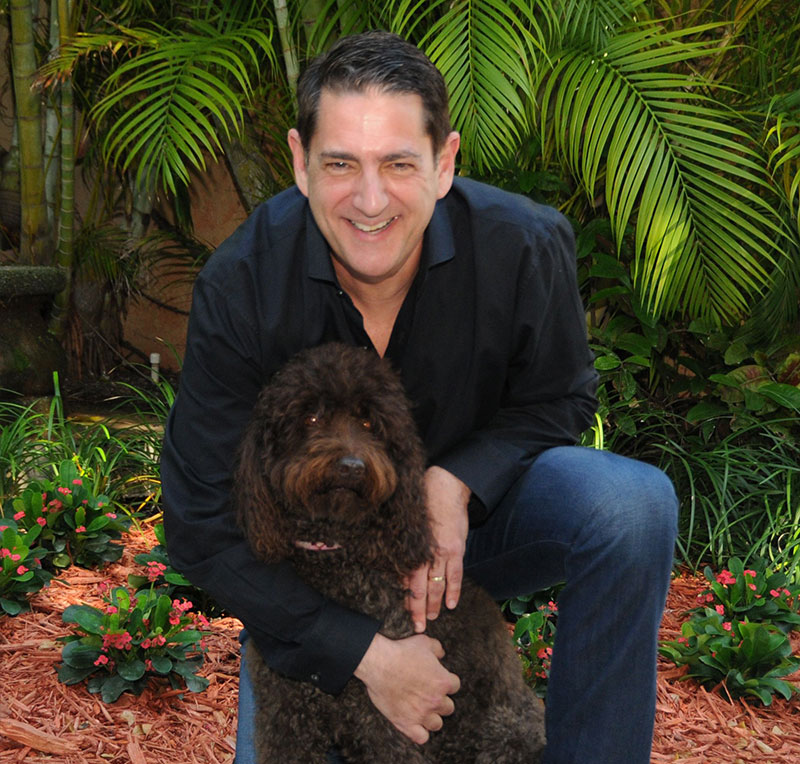 Professional photo of Jeff Karson with a dog