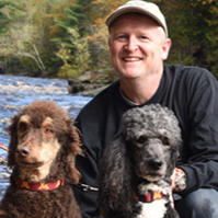 Dr. Bob Larocca with two poodles