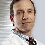 Dr Phillip Fox in a lab coat