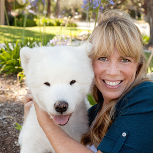 Dr Mary Gardner with a White Dog