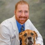 Dr. Adam Lancaster with a boxer