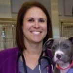 Dr Lenore Bacek with a gray and white dog