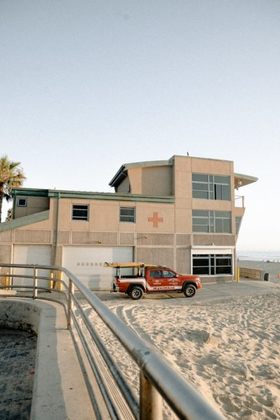 red-pickup-truck-parked-outside-lifeguard-station-2959588